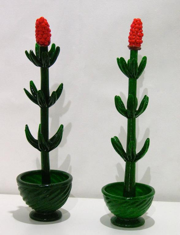 A whimsical Italian pair of flower plants in pots, exquisite quality of the blown Murano glass and detailing of organic execution, with textured stems and fleshy leaves, topped with red flowers so well realized that they seem real. Ideal as