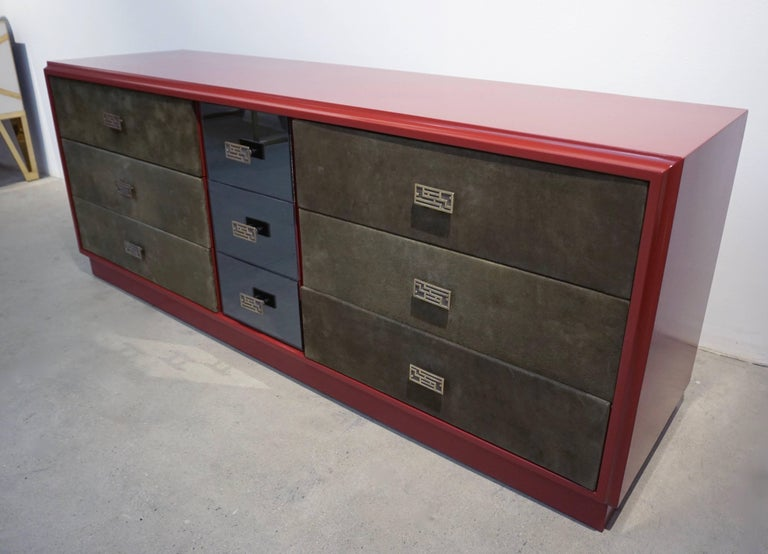 This nine-drawer vintage sideboard/credenza is a unique design attributed to Luciano Frigerio (Desio, 1928 – Sanremo 1999), an Italian designer, artist and musician. His pieces are distinguished by a great attention to details like the molded