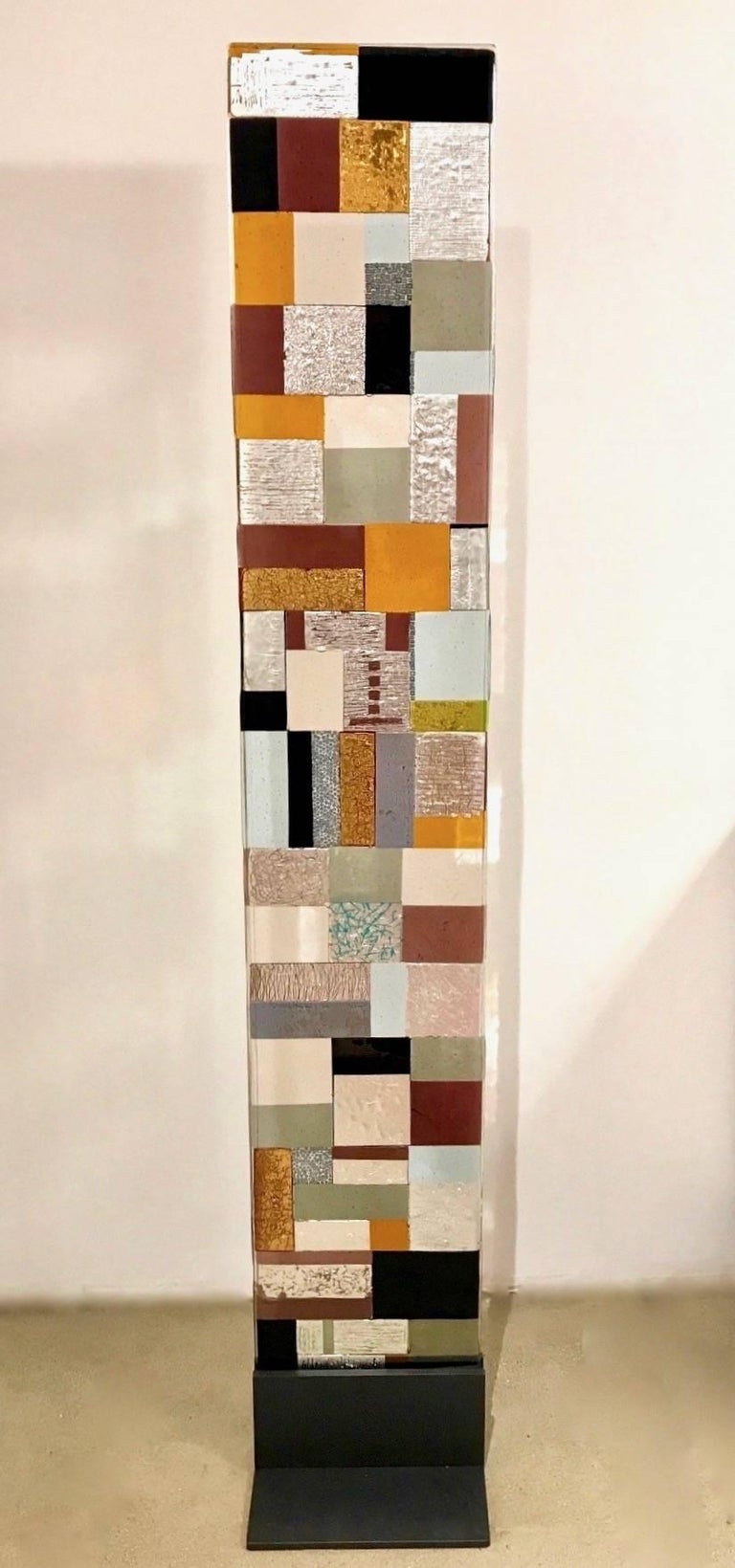 Contemporary modern Murano Art glass sculpture, a decorative panel displayed on a dark gray iron base, realized as a colorful Mosaic, gray, yellow, burgundy, white and black murrine, aqua blue, amethyst purple glass with silver and gold accents,