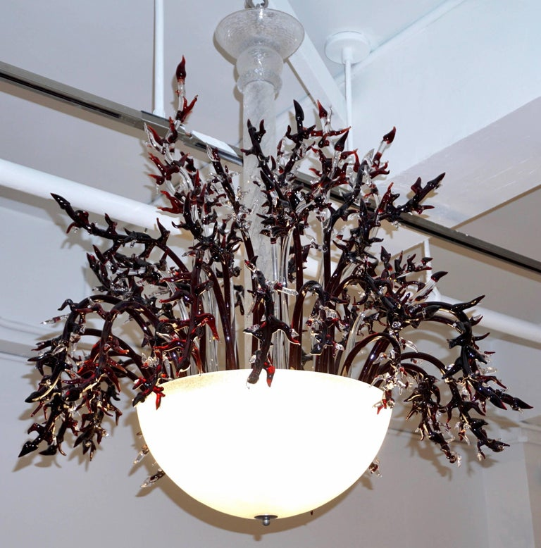 One-of-a-kind vintage Italian Murano glass chandelier of lush design, the frosted white blown Murano glass parts, central pole and half moon bowl are handcrafted with crackled texture giving a precious effect. This is a gem with very rare and