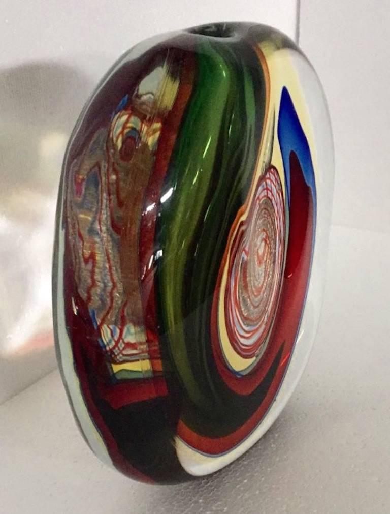 Sophisticated Italian Work of Art by Alfredo Barbini, a sculptural vase of very organic stone shape, worked like an abstract painting, the crystal clear blown Murano glass encloses layers of Sommerso colors, blue, red, green, yellow and a precious