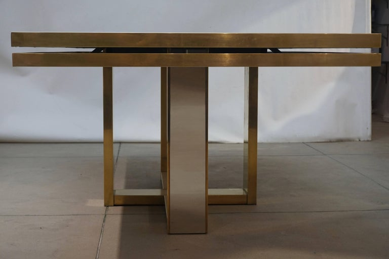 Vintage one of a kind Italian large dining, conference or hall table, exclusive sleek linear design by Giacomo Sinopoli, made by Liwan's, a Roman manufacturer, as described in the documentation. The brass double-frame top is decorated with a