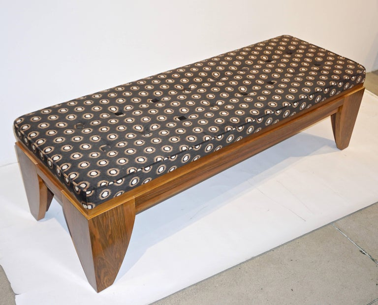 Italian vintage bench, entirely handcrafted in solid walnut, high quality of craftsmanship, the solid wood is elegantly veneered on the outside, the design with a stepped frame and organic clean curved lines, hand covered in a brown velvet with