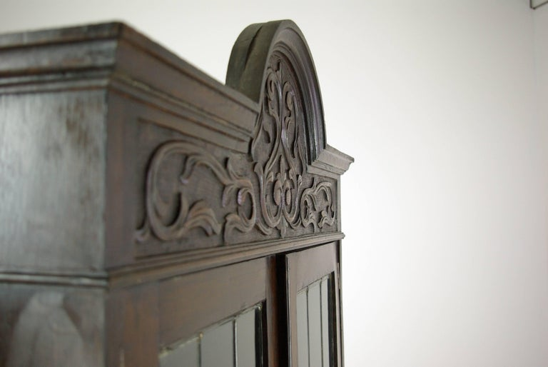 Antique oak bookcase, Arts & Crafts bookcase, Scotland 1910, Antique Furniture, B1054.  Scotland, 1910. Solid oak construction with original finish Cornice with carved detail over a pair of leaded glass doors Three adjustable oak shelves