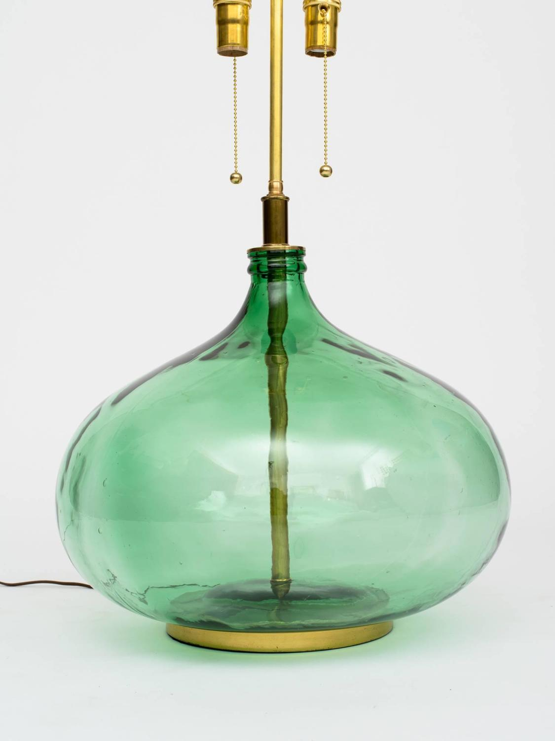 monumental green glass bottle lamps at 1stdibs