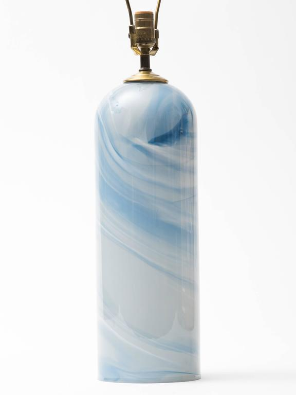 Celestial swirl hand blown glass column lamp with brass hardware.  Few chips to base. Signed, Glasslight, 1987.