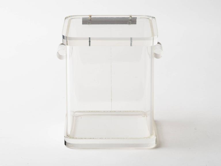 1970s Lucite ice bucket with two rounded handles and hinged lid.