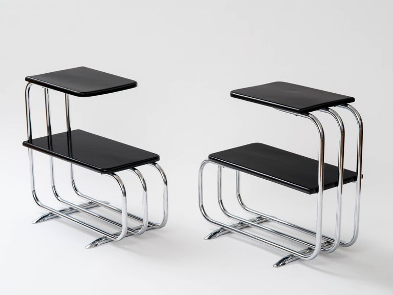 Pair of Machine Age tubular chrome end tables with lacquered wood tops. Original label attached to bases. Designed by Alfons Bach for Lloyd Loom Manufacturing, c. 1930's