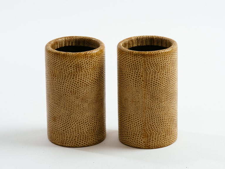 Pair of tan Karl Springer lizard skin dice cups, without dice. May also be used as pen holders for desk top.