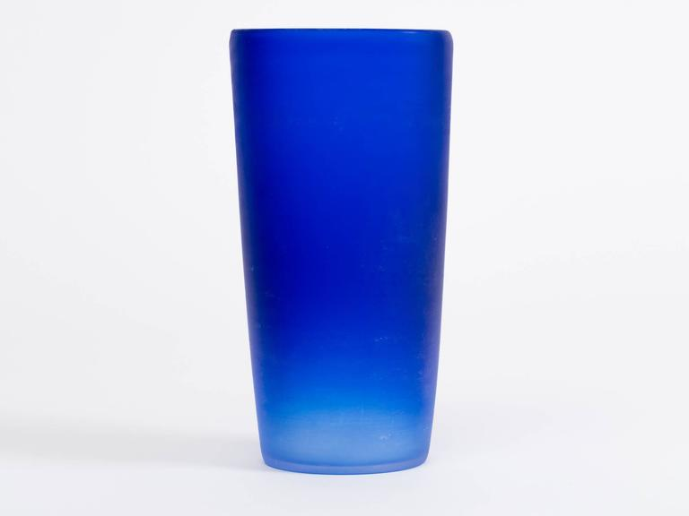Solid cobalt blue Italian glass vase with gradient hues. Handcrafted in the Cenedese workshop, Murano, Italy,c. 1980's.  Engraved signature to bottom,  Cenedese.   After World War II, in 1946, after being tutored by various glass masters,  Mr. Gino