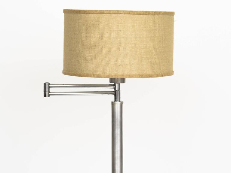 Machine Age brushed aluminium adjustable swing arm floor lamp with milk glass shade diffuser.
