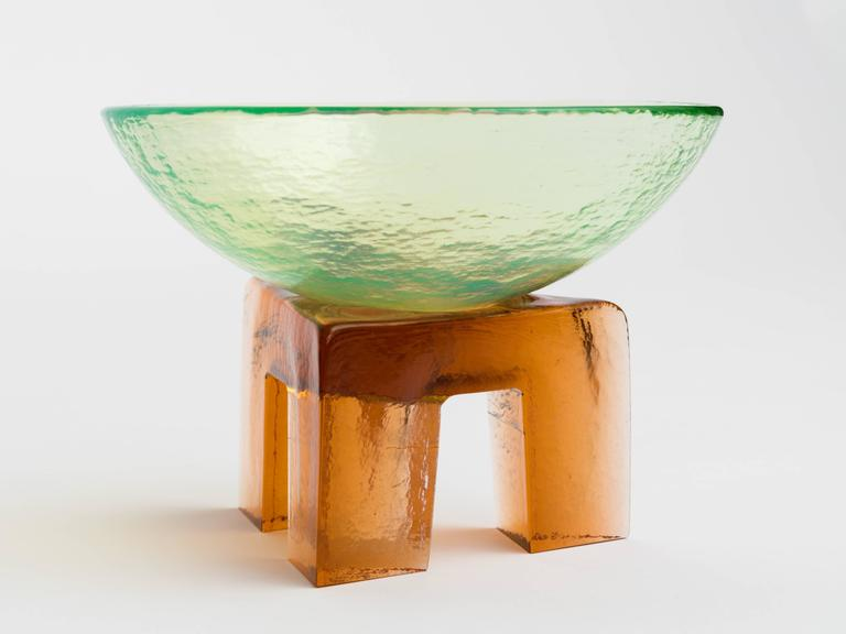 Memphis style art glass bowl sculpture on pedestal. The light orange pedestal is a symbol of fire and earth elements, the celestial colored bowl symbolize the air and water elements. A magical sculpture. Bowl measures 8.8 diameter x 3.2