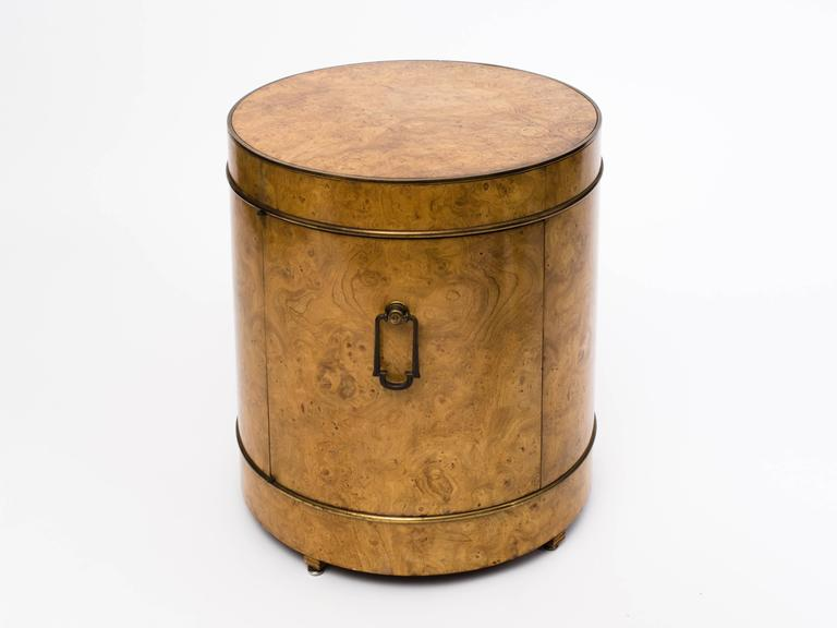 Rich burl wood drum bar cabinet with brass piping detail and heavy brass door pull. Designed by Bernhard Rohne for Mastercraft, circa 1970s.