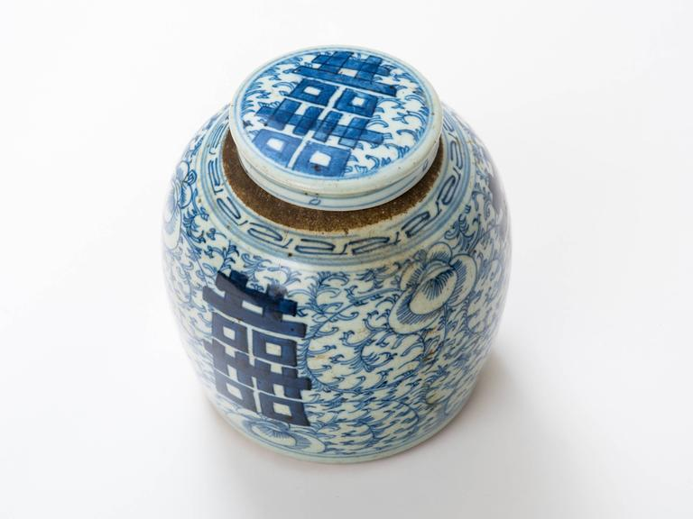 Large blue and white antique ginger jar with finely detailed hand painting.