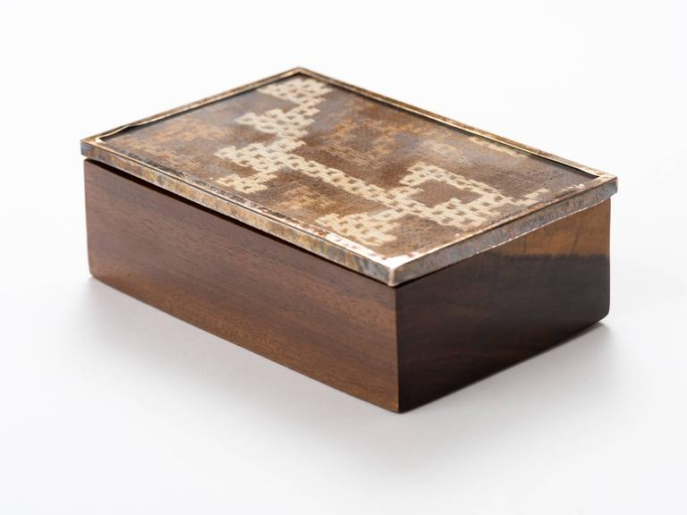 Peruvian exotic wood box with nickel framed ancient Nazca textile top.