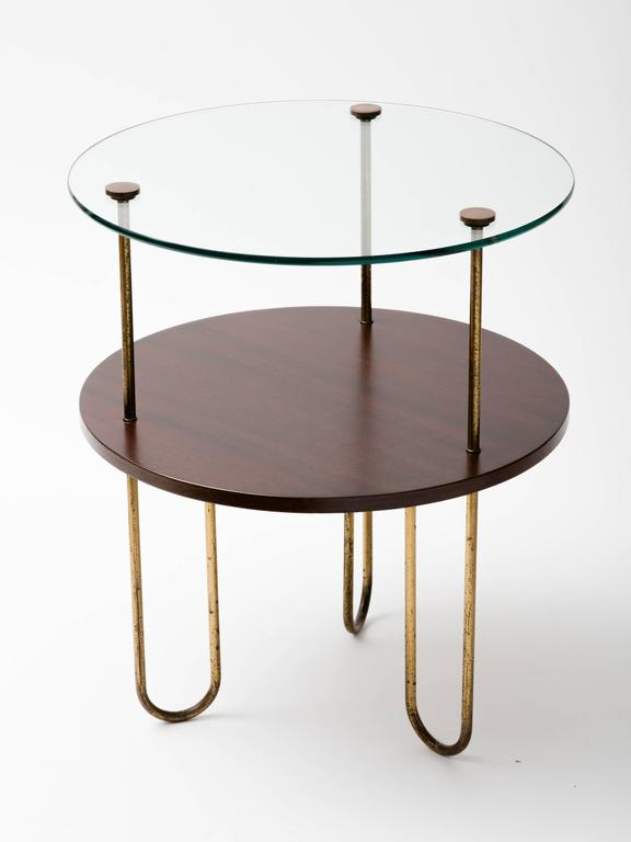 Original Art Deco circular walnut gueridon with curved hairpin legs. Copper hardware attaches glass top to table. Metal legs have distressed patina, which gives table authenticity.