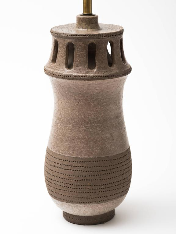 Monumental incised stoneware lamp. Newly wired single socket with solid brass hardware. Lamp body measures 21 inches height. Overall height 33.5 inches, diameter 9 inches.Signed and numbered on bottom, Made In Italy.  Shade not included.