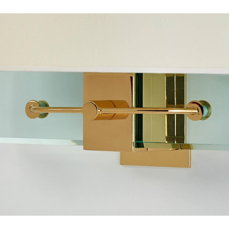 Nathalie Grenon for Fontana Arte. A stunning pair of Fontana Arte glass and polished brass sconces, designed by Nathalie Grenon for Bulgari in 1990. Rewired for use in the USA. Dimensions: 13.5 W x 15 H x 7 proj.