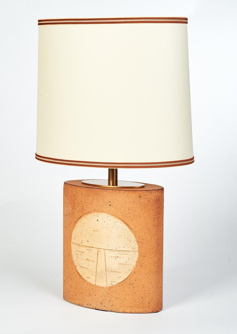 France, 1970s An unglazed oval ceramic table lamp incised with abstract geometric motifs. Part of a series in different forms, including a matching lamp of the same dimension but different motif to make a pair. (see last three images) Measures: