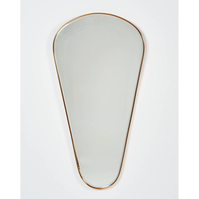 ITALY, 1950s. Tear-drop mirror, Brass frame with beveled mirror. 20 x 40. Can be hung in reverse : 40 x 20. Aging to silvering on the mirror
