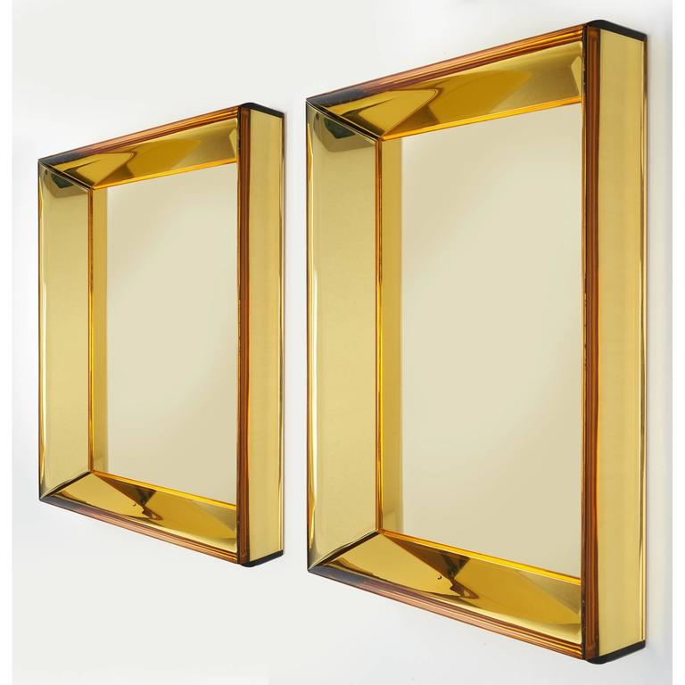 Roberto Rida (b. 1943). A magnificent mirror by Roberto Rida, produced using richly colored vintage Italian yellow mirrored and ground glass from the 1950s. Dimensions: 25 W x 33 H x 5 D.