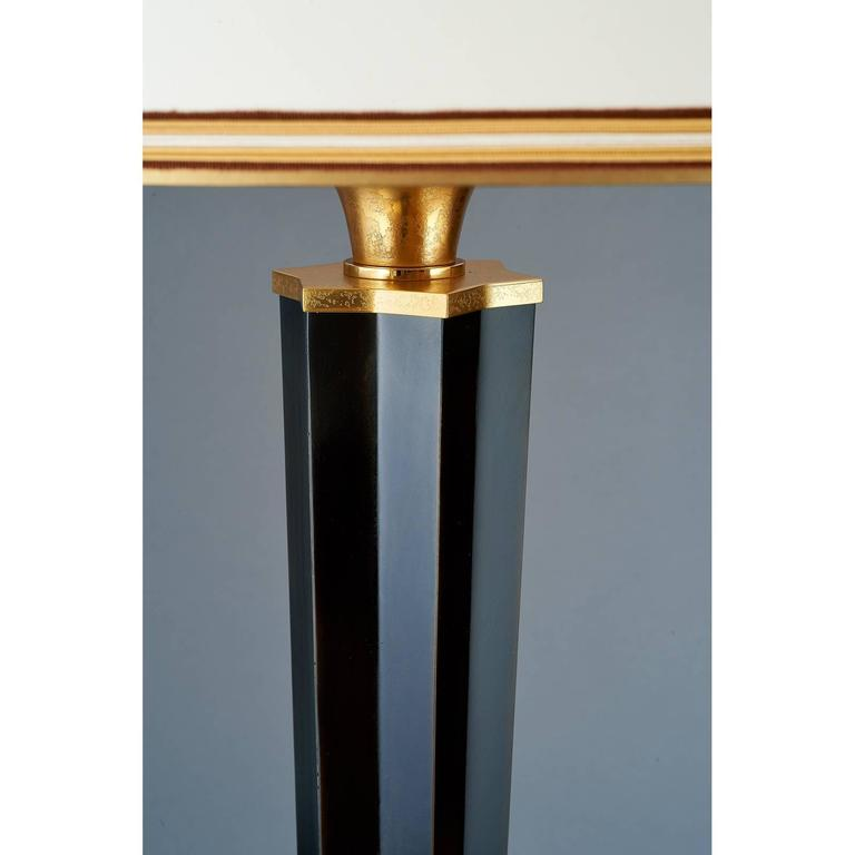 Genet Michon, attributed, An important standing lamp in patinated and gilt metal, with tapered angled star profile shaft and acid washed bronze mounts France, 1950s Measure: 78 H X 23 D Rewired for use in the US. with three standard base bulbs