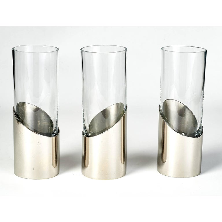Gabriella Crespi (1922-2017) Set of three modernist bud vases Silvered brass and glass, Signed on base . Italy, 1970s Dimensions: 7 H x 2.5 diameter Priced and sold as a set.
