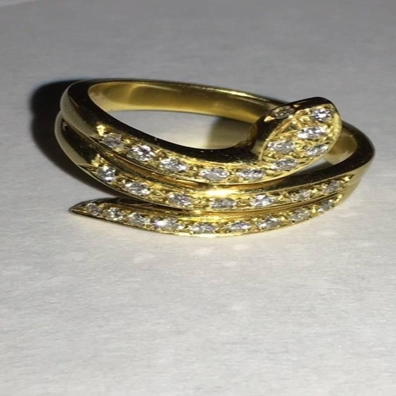 18 karat antique yellow gold snake ring with diamonds at