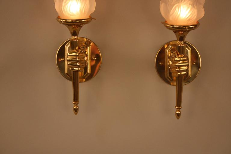 Wonderful Pair Of Polished Bronze Hand Hold Torch Bronze Wall Sconces.