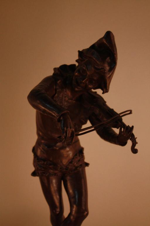Brown patina bronze sculpture of harlequin violinist by Jules Weyns.