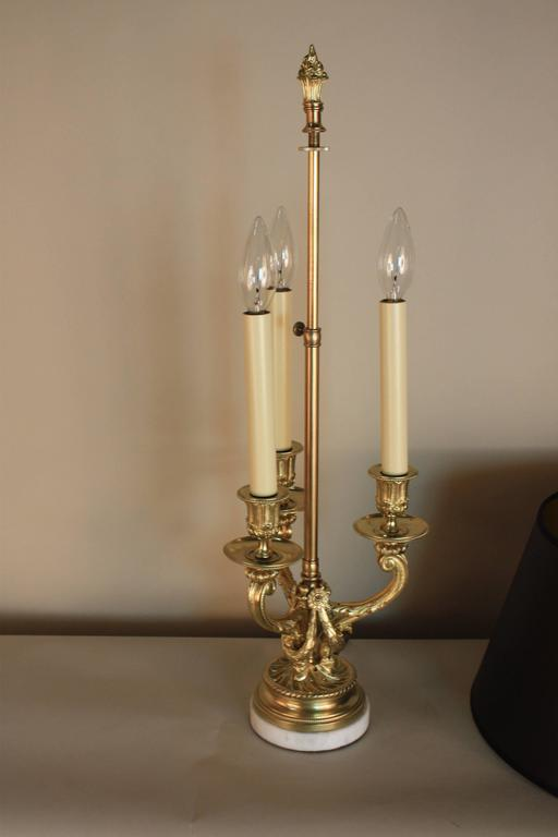 Very fine French bronze candelabra, electrified to a table lamp with withe marble base and hardback black lampshade.