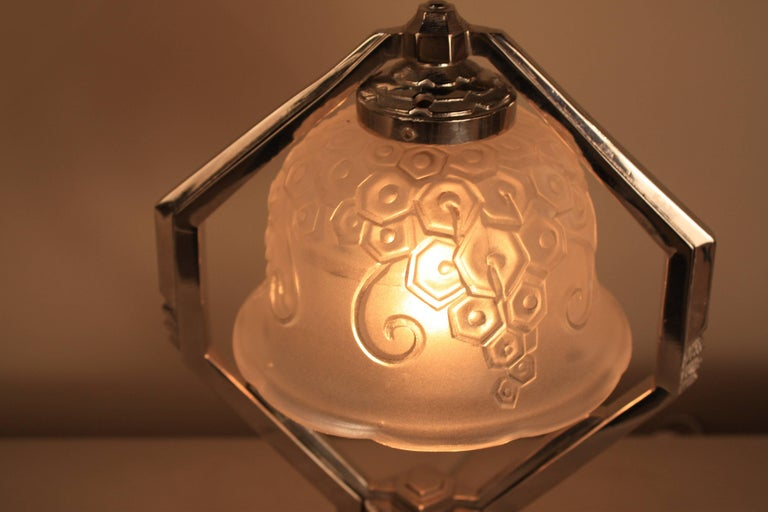 A rare and beautiful nickel on bronze French Art Deco table lamp with clear frost glass shade.