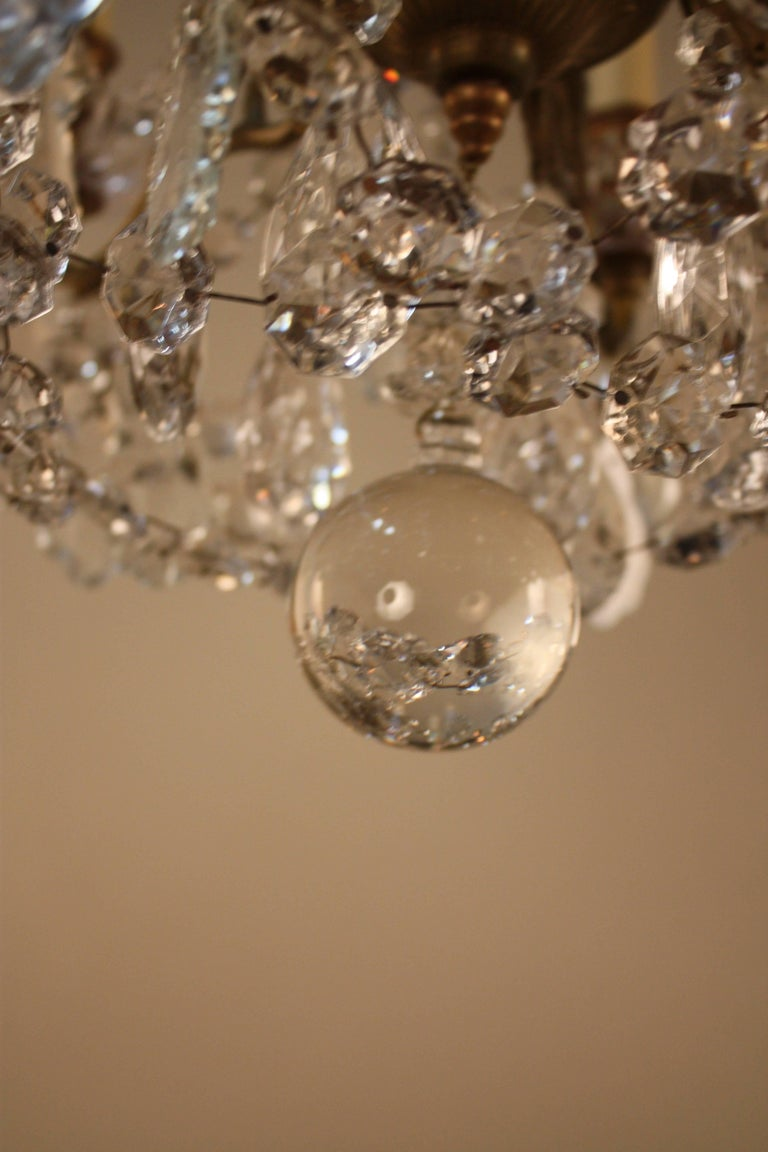 French Early 20th Century Crystal And Bronze Chandelier At