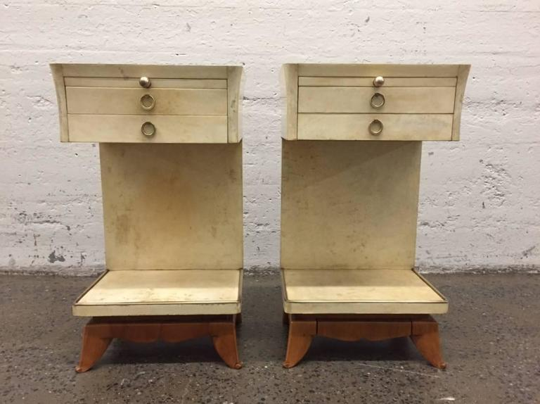 Nightstands have two pull-out drawers, a pull-out tray and bronze hardware. Nice sculpted wood legs. Has bronze trim to the bottom of the shelf.