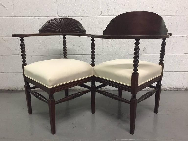 Tete a Tete with carved wood frame and upholstered, linen-blend, cushioned seats.