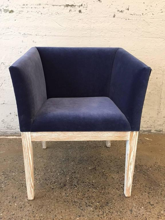 Pair of French cerused oak club or lounge chairs upholstered in blue velvet. Style of Francisque Chaleyssin.