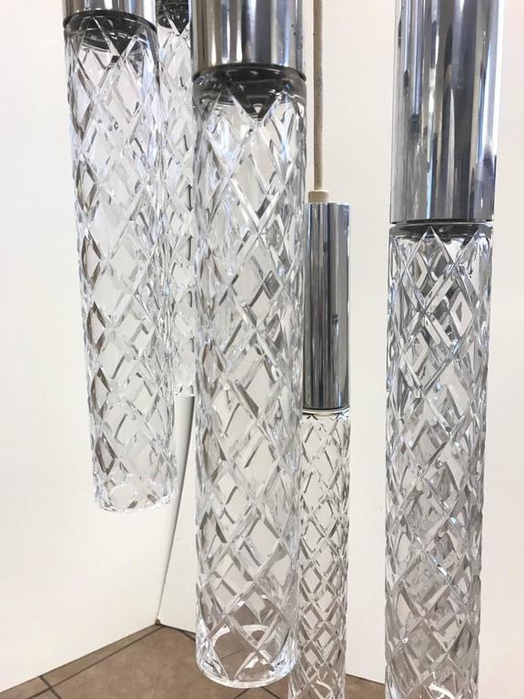 Glass and chrome pendant style of Fontana Arte. Has six cylindrical glass pendants with chrome tops.