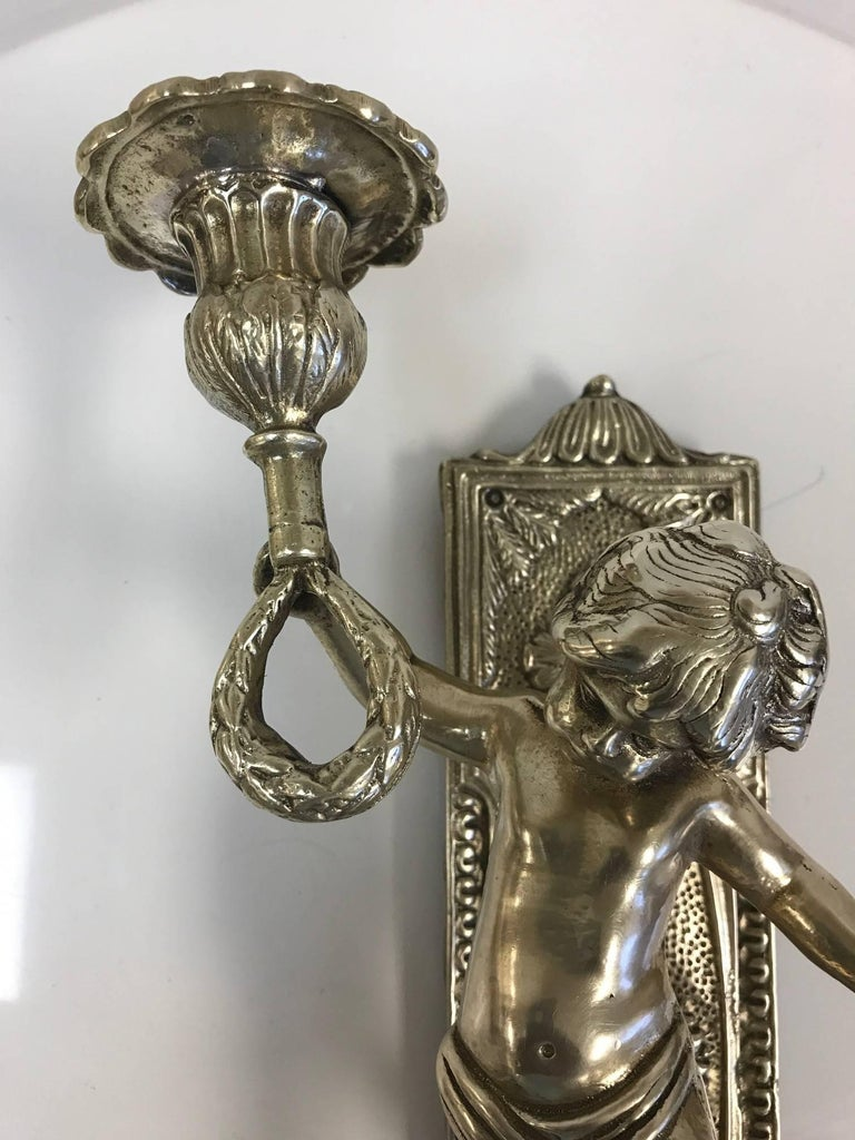 Pair of bronze cherub sconces.
