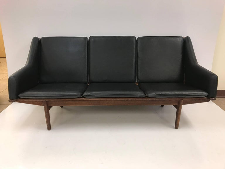 Danish Leather Sofa by Poul Volther. Black leather sofa with oak frame.