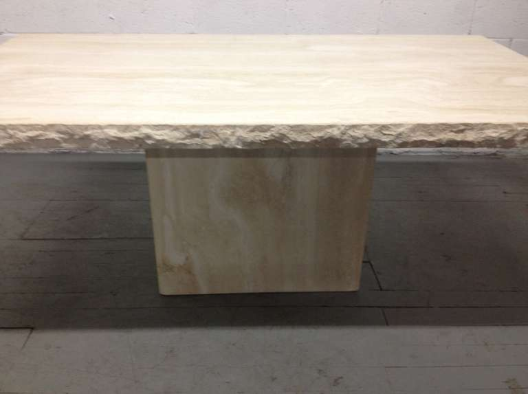 Large Italian travertine table or dining table. The top and the base has a smooth finish. The edges of the top is rough. Can also be used as a conference table.