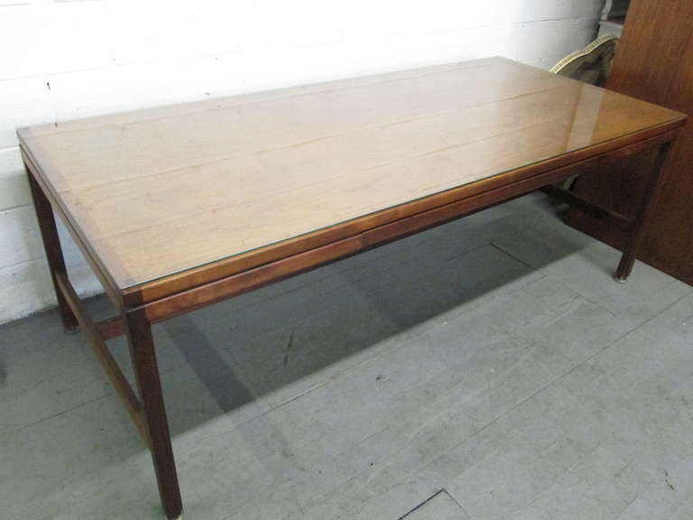 Large vintage Jens Risom solid walnut desk. Has a single pull-out drawer. Desk has a glass top. Great for an office or home.