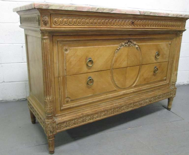 Antique French marble-top dresser. Has original handles, handcut dove tails. Lovely carvings and columns to the front sides. Marble is one inch thick and very colorful. Total of three pull-out drawers.