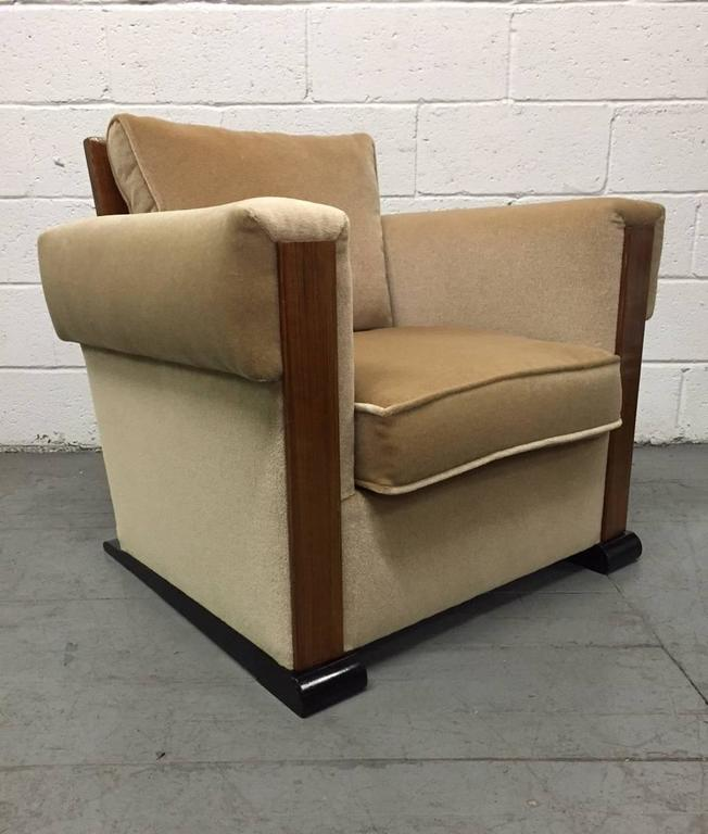 Pair of French Art Deco lounge chairs in mohair. Chairs have black lacquered bases, a nice walnut and burl back with loose cushions. Style of Paul Dupré-Lafon.One chair is missing a back cushion which can easily be replaced.