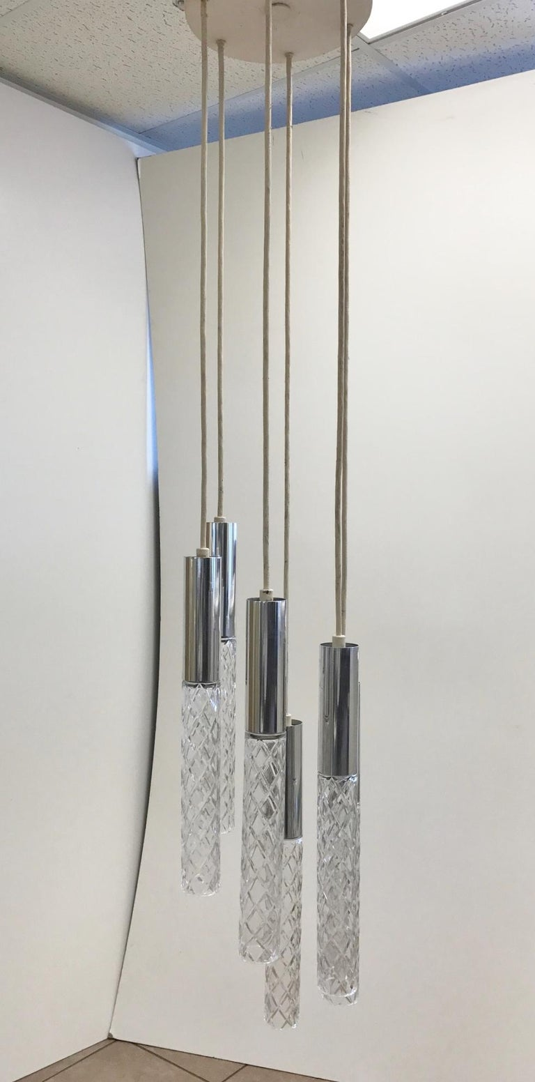 Glass and chrome pendant style of Fontana Arte. Has six cylindrical glass pendants with chrome tops.