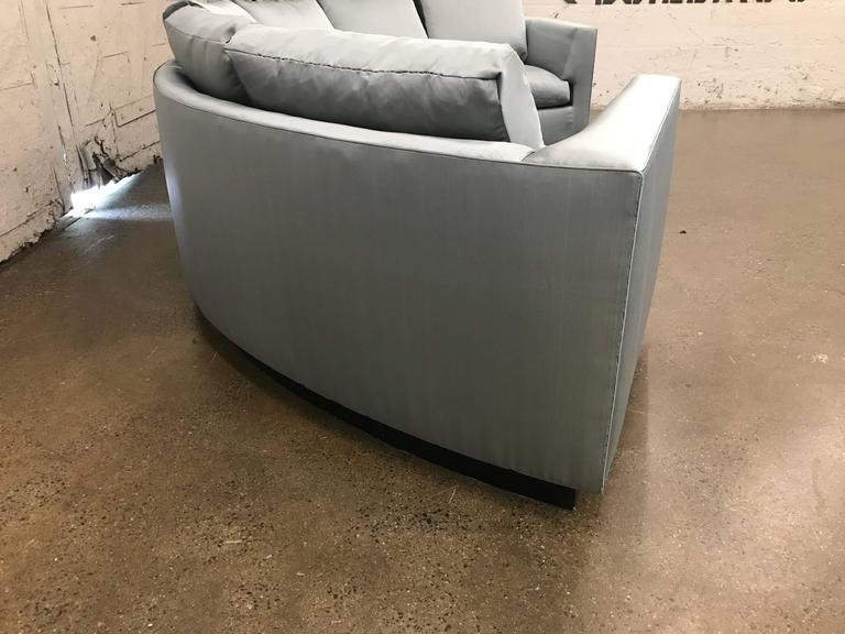 Two-piece sofa sectional in satin with a black lacquered wooden base. The loose cushions are down. Very comfortable sofa. Milo Baughman Style. Each sectional measures: 87 W x 41 D x 34.5 H (height is to the top of back cushions).
