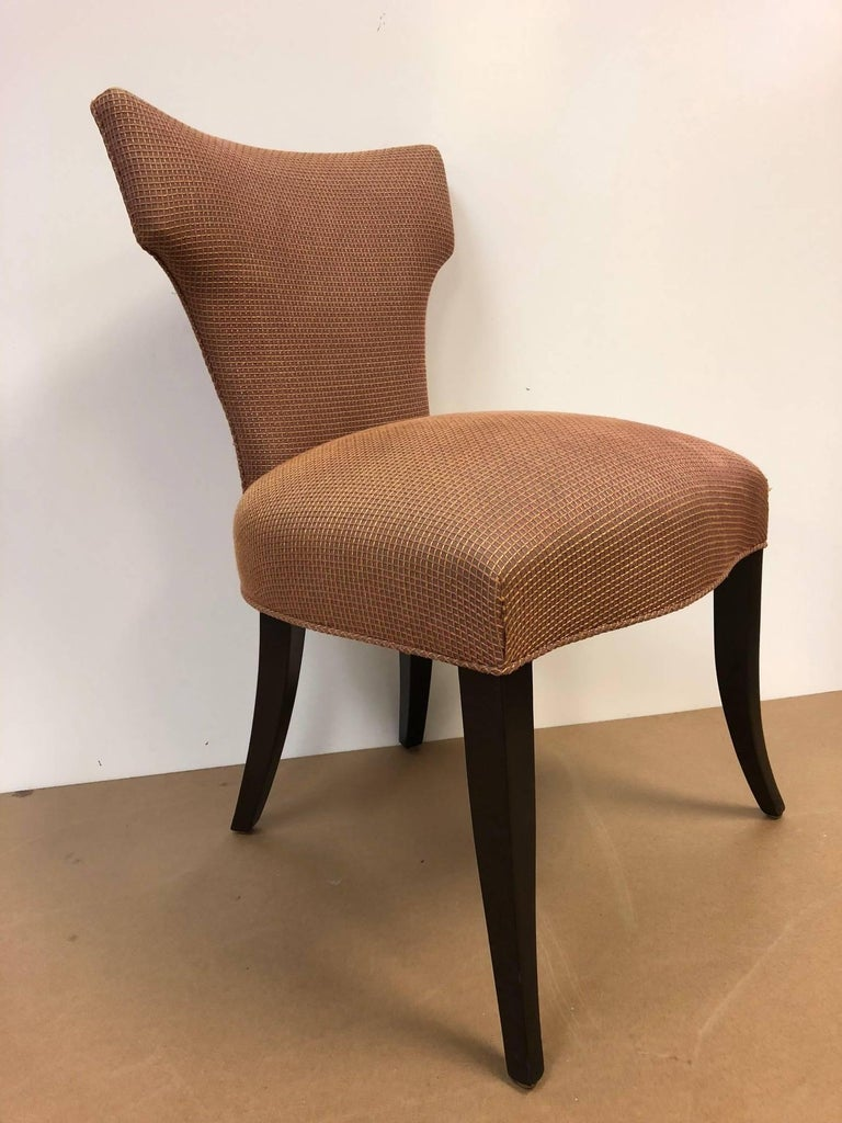 Set of eight Klismos style dining chairs. Has wood legs with a dark mahogany stain, curved upper back with original upholstery.