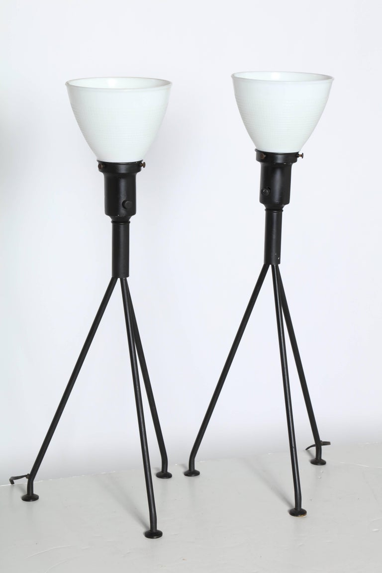 Pair of Gerald Thurston Black Iron Tripod Table Lamps with White Glass Shades In Good Condition For Sale In Bainbridge, NY