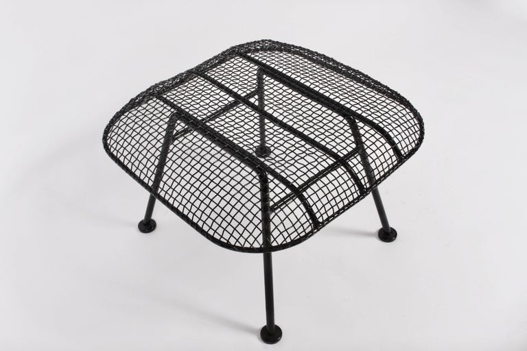 Larger Russell Woodard Black Wrought Iron and Black Mesh Stool. Like new. Freshly powder coated. With Black glossy paint.  Corner to corner measurements: 25W. American Mid Century Modern. Versatile. 1950's. Classic. Lightweight. Comfort. For Indoor