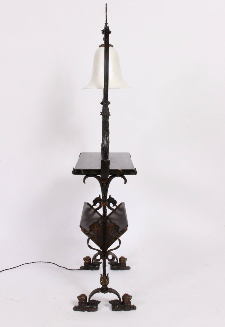 Rare, Turn of the Century Oscar Bach Bronze, Iron, Wood, Marble and Glass Console. Featuring  a Bronze and Iron framework, rectangular (10 D x 20 H) dark gray striated Marble surface. Iridescent Steuben Art Glass bell White shade with pull chain (8