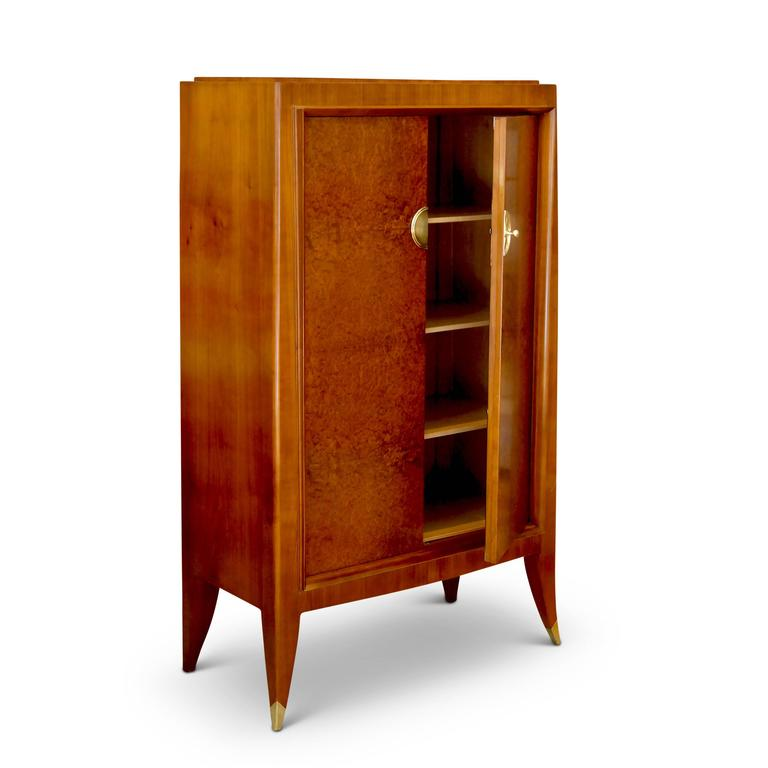Fine cabinet (forming an original custom set with a storage cabinet, also available) by Alfred Porteneuve (1869-1949). The sculptural case-piece is superlatively crafted in fruitwood (likely cherry) with amboyna (burl walnut) veneer on the doors. A
